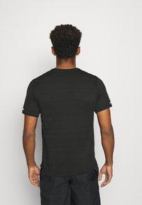 Nike Performance - MILER  - Print T-shirt - black/white - 2