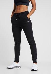 Fila - LAKIN - Spodnie treningowe - black - 0