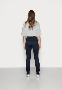 Calvin Klein Jeans - HIGH RISE SKINNY ANKLE - Jeans Skinny Fit - blue - 2