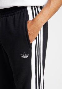 adidas Originals - STRIPE PANEL - Tracksuit bottoms - black/white - 4