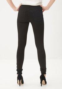 Vero Moda - Slim fit jeans - black - 1