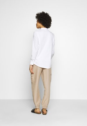 HOSE 7/8 - Trousers - brown
