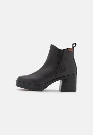NAIARA - Ankle boots - black