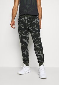 Under Armour - RIVAL - Tracksuit bottoms - baroque green - 0