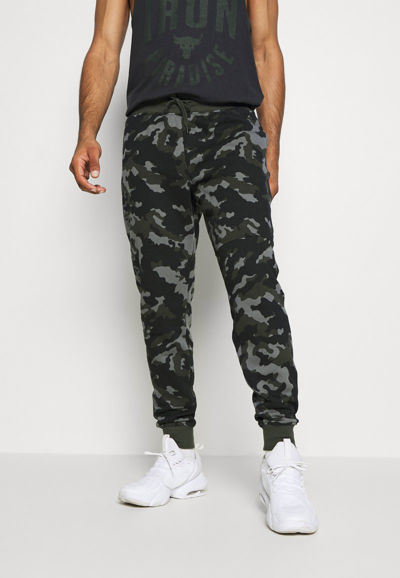 Under Armour - RIVAL - Tracksuit bottoms - baroque green