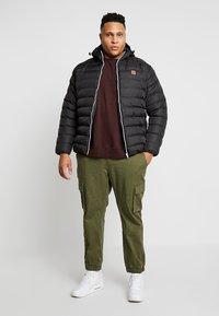 Urban Classics - BASIC BUBBLE JACKET - Winter jacket - black - 1