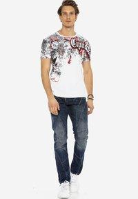 Cipo & Baxx - MIT ZIERNÄHTEN UND REISSVERSCHLÜSSEN - Straight leg jeans - donkerblauw - 1