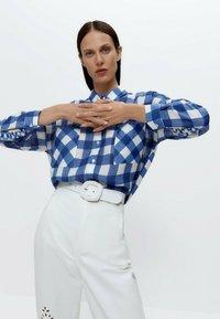 Uterqüe - Button-down blouse - blue denim - 2