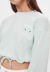 Bershka - MIT SCHLEIFEN - Sweatshirt - turquoise - 3