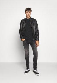 Replay - ANBASS HYPERFLEX BIO - Slim fit jeans - black - 1