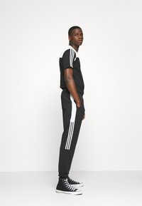 adidas Originals - CLASSICS  - Jogginghose - black/white - 3