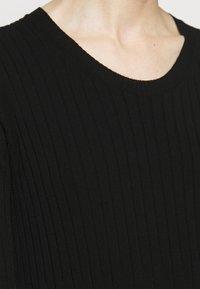 TWINSET - ABITO IN MAGLIA CON BALZINA - Jumper dress - nero/neve - 4