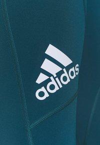 adidas Performance - CAPRI - 3/4 sports trousers - teal - 4