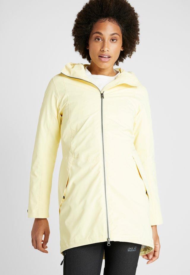 FOLKA WOMEN'S - Waterproof jacket - light yellow