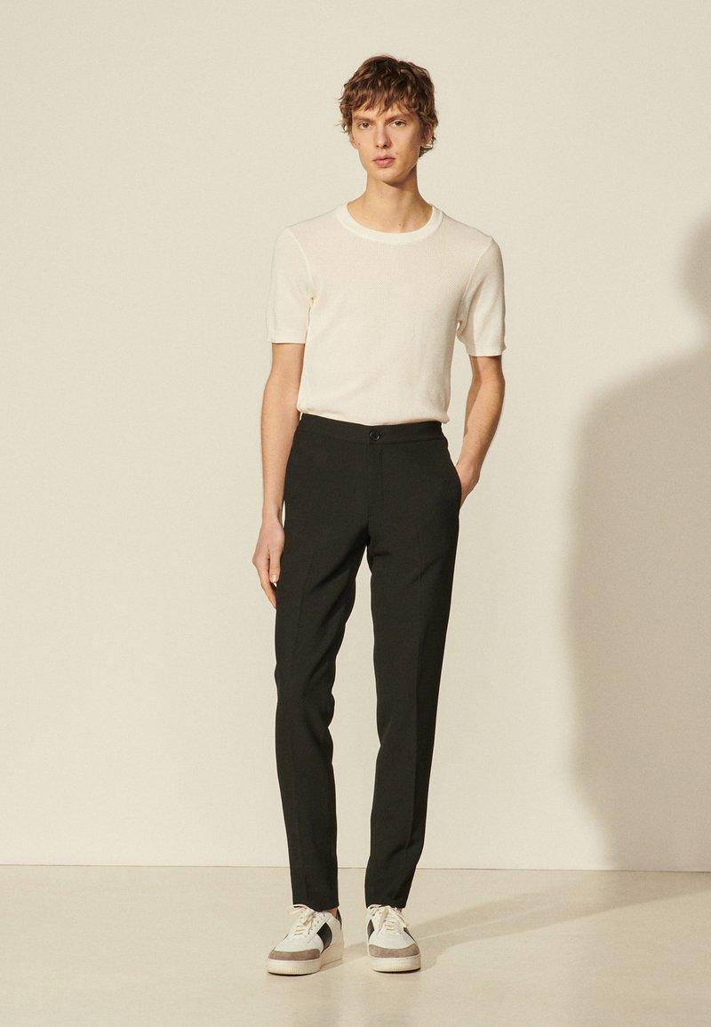 sandro - Trousers - noir