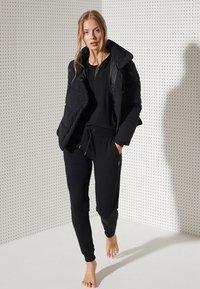 Superdry - FLEX PUFFER - Winter jacket - black - 1