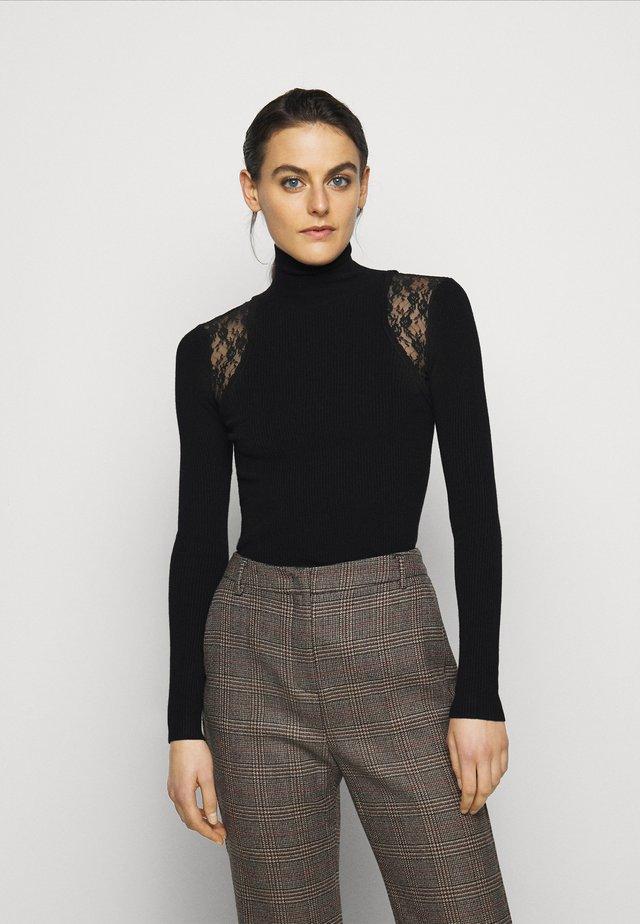 ISLANDA - Stickad tröja - black