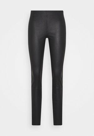 STRETCH LEATHER - SHAMAR - Pantalon en cuir - black