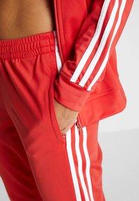 adidas Performance - ESSENTIALS 3STRIPES SPORT TRACKSUIT - Tuta - glow red - 7