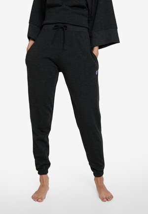 Manuela - Tracksuit bottoms - grey