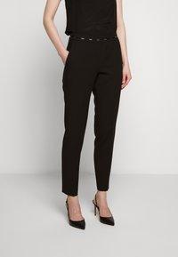 HUGO - HAZENA - Trousers - black - 0