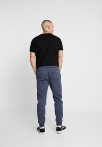 Hollister Co. - Tracksuit bottoms - navy - 2