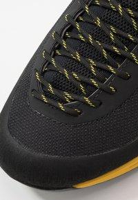 La Sportiva - TX GUIDE - Climbing shoes - black/yellow - 5