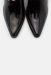 Jeffrey Campbell - Cowboy/biker ankle boot - black - 5