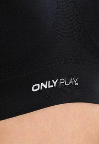 ONLY Play - ONPMIRA SEAMLESS BRA - Medium support sports bra - black - 3