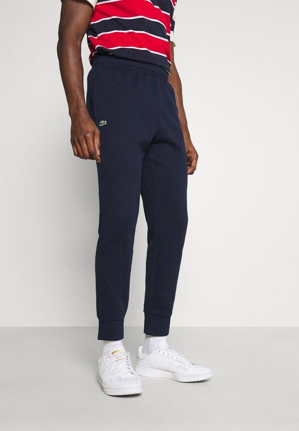 Lacoste Spodnie treningowe - navy blue/granatowy Odzież Męska SMGS