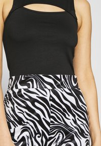 Juicy Couture - JOYPRINTED TROUSERS - Trousers - mono wave - 5