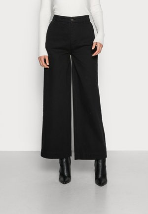 NANGALF PANTS WOMAN - Flared jeans - black