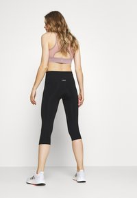 Casall - CLASSIC - 3/4 sports trousers - black - 2