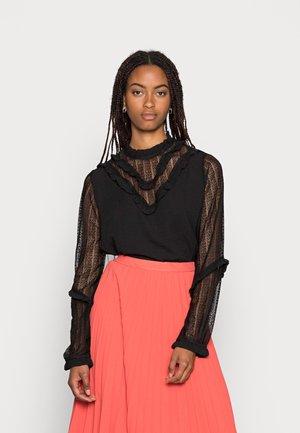 LISA FRILL - Blus - black