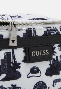 Guess - QUARTO BUMBAG UNISEX - Bum bag - white - 4