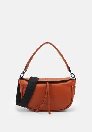 Handbag - cayenne powder