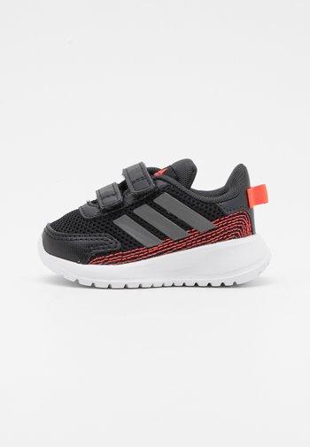 TENSAUR RUN UNISEX - Neutral running shoes - core black/iron metallic/carbon