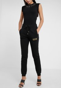 Versace Jeans Couture - Tracksuit bottoms - nero - 0