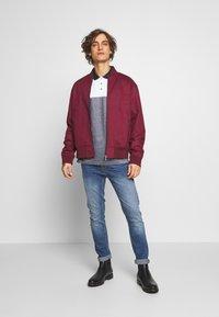 Burton Menswear London - ORGANIC - Slim fit jeans - mid blue - 1