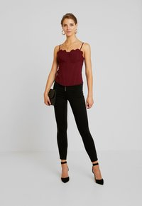 Missguided - VICE BUTTON UP WITH ANKLE ZIP - Jeans Skinny Fit - black - 2