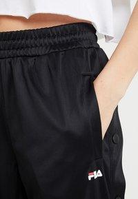 Fila Tall - GERALYN TRACK PANTS - Tracksuit bottoms - black - 4