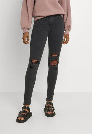 710 SUPER SKINNY - Jeans Skinny Fit - black