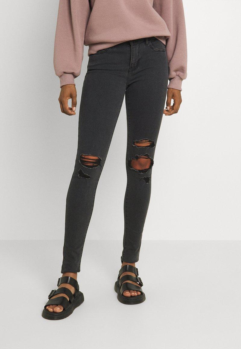 Levi's® - 710 SUPER SKINNY - Jeans Skinny Fit - black