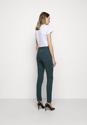 TAIKA - Trousers - scarab green