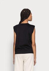 someday. - KARELA - Print T-shirt - black - 2