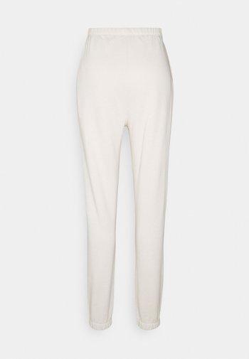 COZY PANTS - Pantalones deportivos - cream
