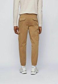 BOSS - Cargo trousers - beige - 2