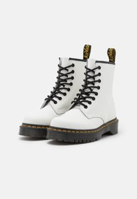 Dr. Martens - 1460 BEX 8 EYE BOOT UNISEX - Lace-up ankle boots - white smooth - 1