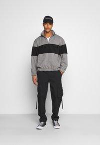 Topman - WEBBING - Cargo trousers - black - 1