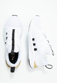 Puma - PROWL ALT ASYM - Sports shoes - white/black - 1